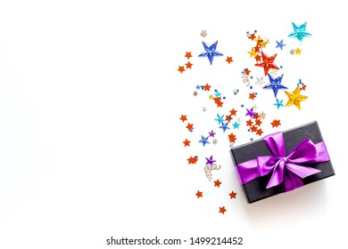 gifts with confetti on white background top view mockup