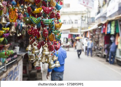 gifts display at shopfront and blur background of marketplace in Pushkar city, Rajasthan, India.