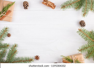 Gifts and fir branches form a frame. Concept blank for a Christmas card. Copy space, top view.
