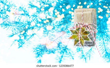 Gifts at the fir-tree in bright lights, bokeh