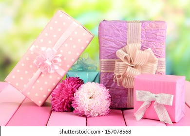 Gifts and flowers, on nature background