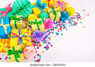 Gifts, garland, festive decor and confetti. Party decoration.