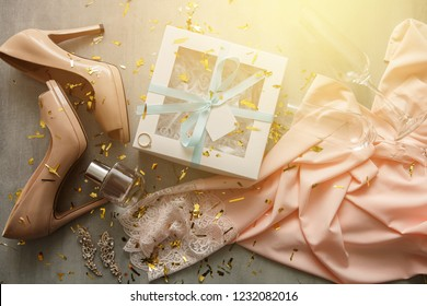Gifts for merry christmas: silk pajama, shoes, engagement ring, shoes, gift box, perfume, jewelry, glasses, confetti. Christmas concept