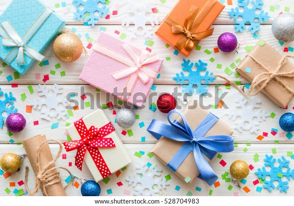 gifts on the background of Christmas decorations and snowflakes