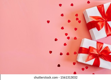 Gifts on pink background with copy space.