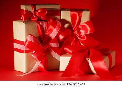 Gifts packed with craft paper and colorful satin ribbons