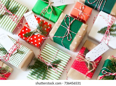 Gifts packed in striped paper and polka dots. Red and green colors.