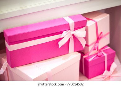 gifts pink shades tied with ribbons
