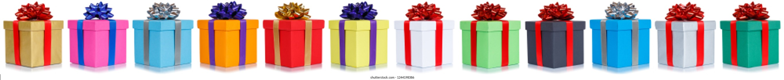 Gifts presents Christmas birthday gift present in a row isolated on a white background