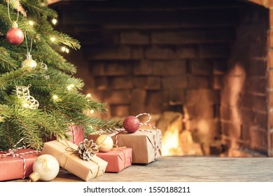 Gifts under the Christmas tree in the room with a fireplace on Christmas eve.