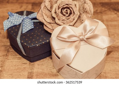 Gifts for Valentine's day in vintage style on wooden background.