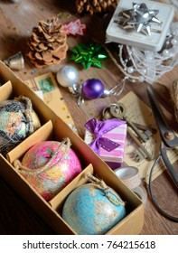 Gifts and vintage christmas ornaments on wooden table