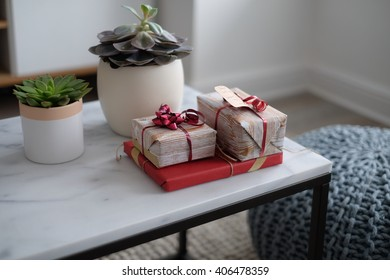 Gifts wrapped on marble table