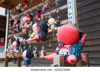 Gifu, Japan - Aug 02 2017- Sarubobo at Hida Kokubun-ji Temple in Takayama, Gifu, Japan. sarubobo is a Japanese amulet, particularly associated with the town of Takayama in Gifu Prefecture.