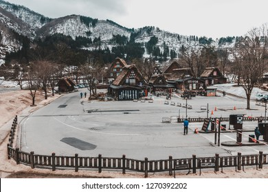 "Gifu, Japan - January 7, 2016: Tourist walking in the parking lot of Shirakawa Go historical village featuring shop in traditional japanese style house ""Wada"""
