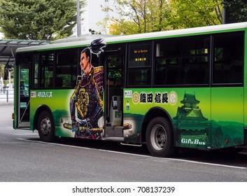 Gifu, Japan - October 5, 2015: Gifu city bus with images of Oda Nobunaga, a famous warlord and city founder