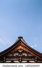 Gifu, JAPAN - Old historic ancient wooden main hall Honko-Ji temple carved wood roof Tympanum. Hida Furukawa old town.  Under Evening light and blue sky
