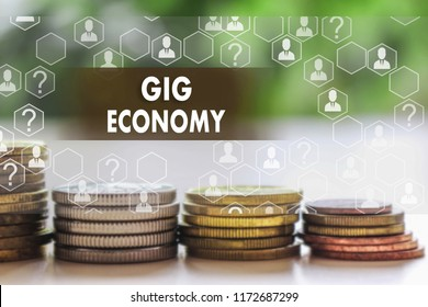GIG ECONOMY on the touch screen with a  blur financial background. The concept GIG ECONOMY