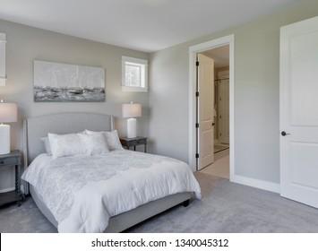 Gig Harbor, WA / USA - March 10, 2019: Luxury bedroom interior
