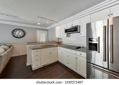 Gig Harbor, WA, USA - March 17, 2021: Modern residential kitchen interior