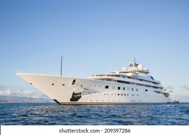 Gigantic big and large luxury mega or super motor yacht on the ocean.