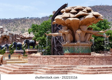 Gigantic monkey and elephant statues on fountain near bridge in famous Lost City in Sun City, South Africa.