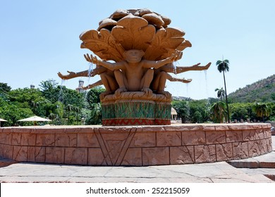 Gigantic monkey statues on fountain near bridge in famous Lost City in Sun City, South Africa.
