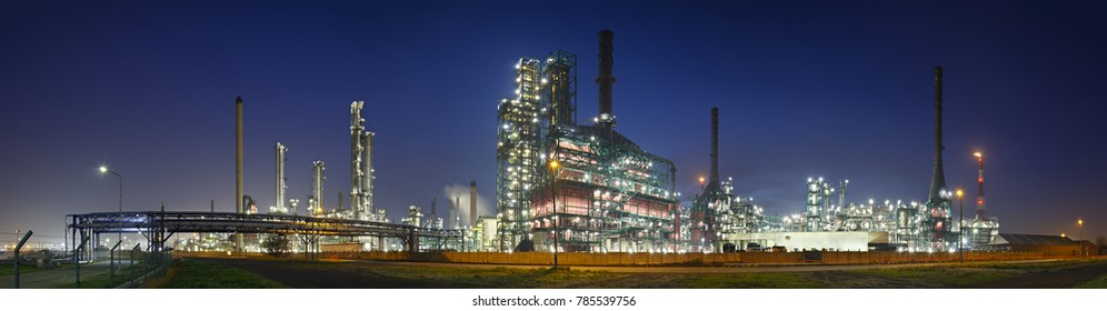 A gigantic oil refinery in the harbor of Antwerp at night.