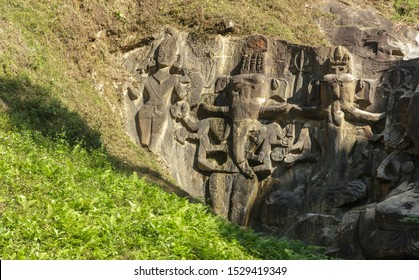 The gigantic sculptures of Ganesha and other mythological figures in the green hills of Unakoti at the archaeological site in the state of Tripura in Northeast India.