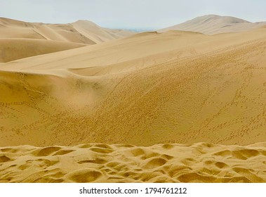 Gigantic yellow sand dunes are beautiful,surreal,mesmerizing. Oasis Huacachina, Atacama desert,Peru.Dunes are several hundred feet high.Ideal place for sandboarding.Largest sand dunes in South America