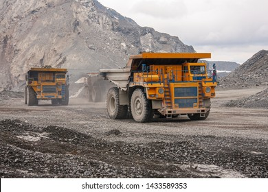 Gigat dump trucks are working in the mine for the production of apatite in the Murmansk region carrying rock. Extraction of minerals in the harsh highlands.