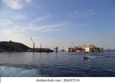 GIGLIO ISLAND, ITALY - JULY 19, 2014: Front view of the wreck of Costa Concordia on July 19, 2014 in Giglio Island, Italy.