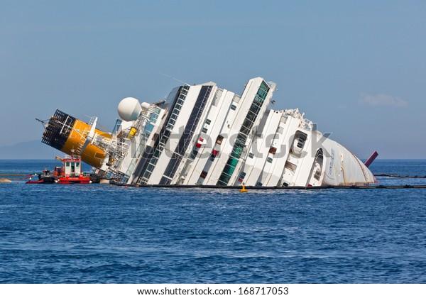 GIGLIO, ITALY - APRIL 28, 2012: Costa Concordia Cruise Ship at Italian Giglio Island Coastline after Shipwreck at January, 13, 2012.