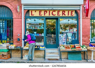 Gigondas, France - Oct 11, 2016. An overhead sign saying Grocery Shop, and the window advertises that it sells fruit and vegetables, cheese, cooked meats, bread, Viennese pastries and cold drinks.