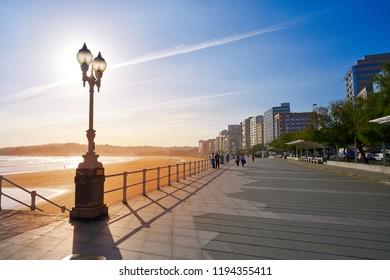 GIJON, ASTURIAS, SPAIN - JUNE 7: San Lorenzo beach sunrise in Gijon promenade on June 7, 2017 in Gijon, Asturias, Spain