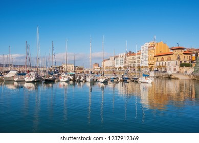Gijon cityscape. Yatchs in marina port of Gijon, Asturias, Spain.