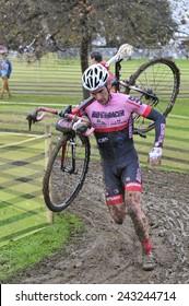 GIJON, SPAIN - JANUARY 11: Cyclocross Championships Spain in January 11, 2015 in Gijon, Spain. The cyclist Antonio Suarez Fernandez compete in elite cycle race of cyclocross championship of Spain.