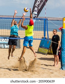 GIJON, SPAIN - JUL Jul 2014: Participants in the Voley Playa Tour 2014 Open Villa de Gijon , Spain, on Sunday, Jul 13, 2014.