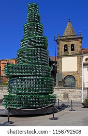 Gijon, Spain - May 23, 2018: Monument made with cider bottles in Gijon, Spain