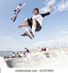 GIJON, SPAIN  Sep 2014:  Teenage skateboarders training in a skatepark of Gijon. Spain. September 11, 2014