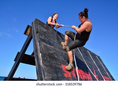 GIJON, SPAIN - SEPTEMBER 19: Storm Race, an extreme obstacle course in September 19, 2015 in Gijon, Spain. Participants in extreme obstacle course jumping a wooden wall.