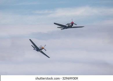 GIJON-SPAIN - JULY 26: Curtiss P40 Warhawk and P51 Mustang  during exhibition in X AIR FESTIVAL on july 26, 2015 in Gijon,Spain.