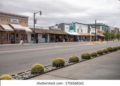 GILBERT, AZ - JUNE 12, 2020: Businesses along road in downtown Gilbert Arizona. Foreground sidewalk
