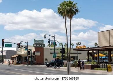 GILBERT, AZ - JUNE 12, 2020: Street view of downtown Gilbert Arizona Liberty Market and palm trees