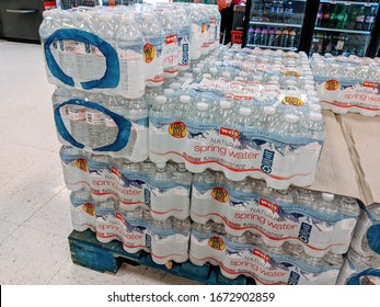 Gilbertsville, Montgomery County, PA, USA - March 12, 2020 - Cases of Bottled Water for Sale at Weis Market During Coronavirus / Covid-19 Health Scare and Grocery Shortage Due to Panic Buying