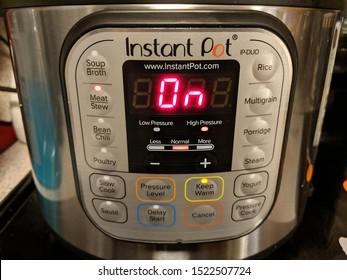 Gilbertsville, Pennsylvania / USA - September 18, 2019: Instant Pot Pressure Cooker Turned On