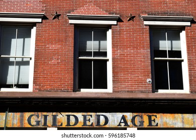 Gilded Age sign on brick building