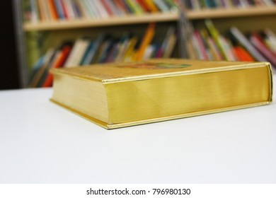 Gilded book on the table