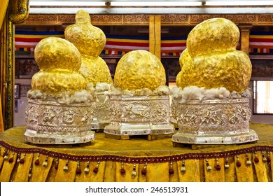 Gilded Buddha statues at Phaung Daw Oo pagoda in Inle Lake, Shan State, Myanmar. The images have been covered in gold leaf by Buddhist devotees to the point that their original forms cannot be seen.