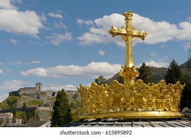 The  gilded crown ad cross in Lourdes, France